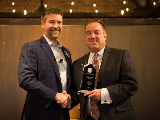 Jeff Grebe, right, is awarded Realtor of the Year at the Commercial and Residential Real Estate Awards held at The Press Room in Knoxville on Tuesday, Feb. 12.