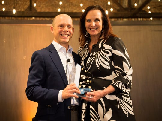 Heidi Adams, right, is presented with the Commercial Broker of the Year award by Justin Cazana at the Commercial and Residential Real Estate Awards. The event was held at The Press Room in Knoxville on Tuesday, February 12, 2019.