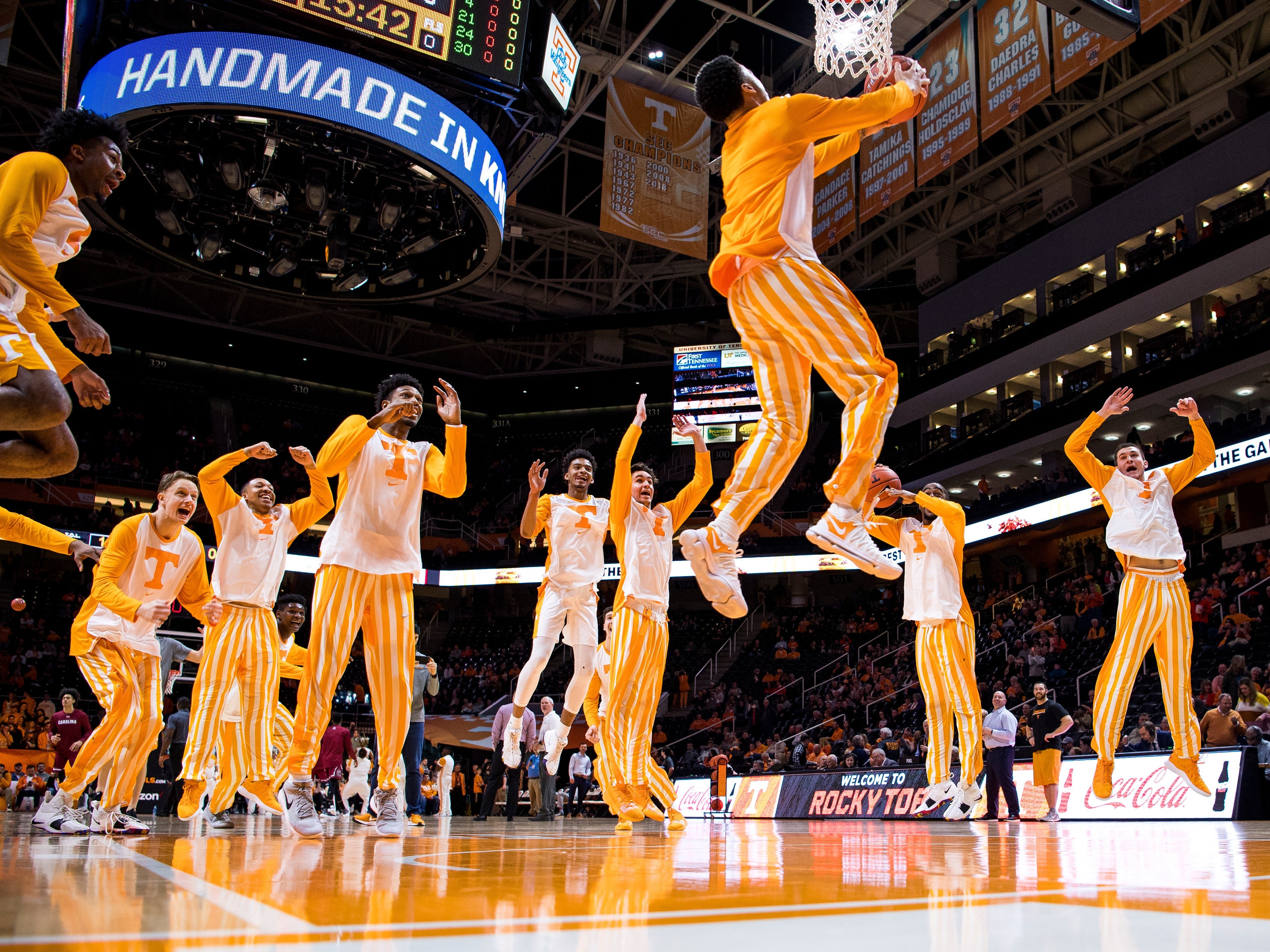 """Tennessee guard Lamonte Turner (1) takes the dunk for the Vols' pregame """"One Fly, We All Fly"""" tradition before Tennessee's home SEC game against South Carolina at Thompson-Boling Arena in Knoxville on Wednesday, February 13, 2019."""