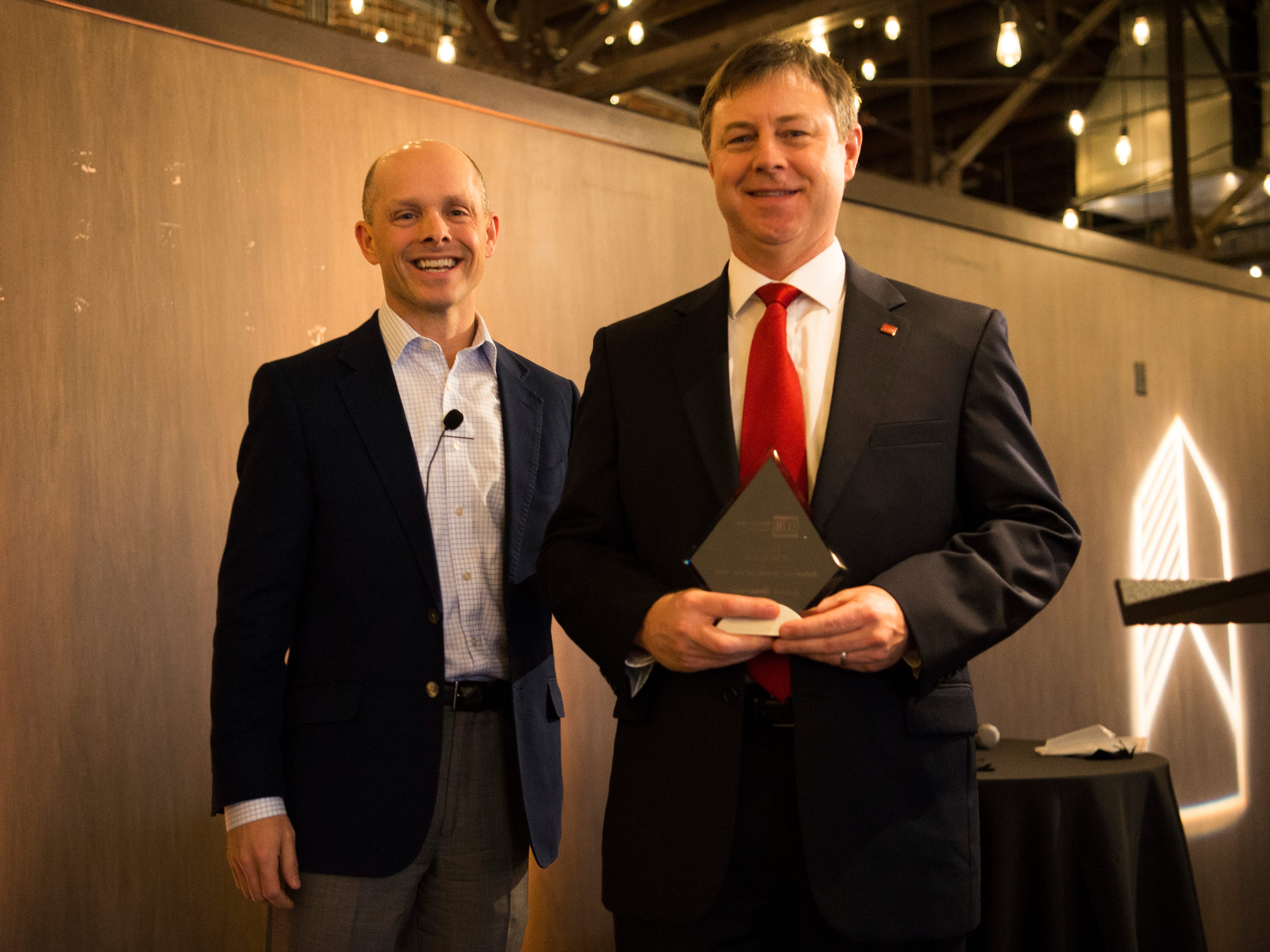 James Roberson, right, is awarded Industrial Broker of the Year at the Commercial and Residential Real Estate Awards held at The Press Room in Knoxville on Tuesday, February 12, 2019.