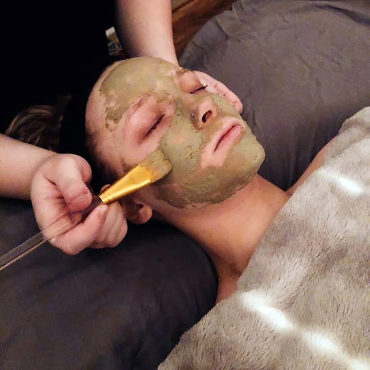 A client experiences the luxury of a facial.
