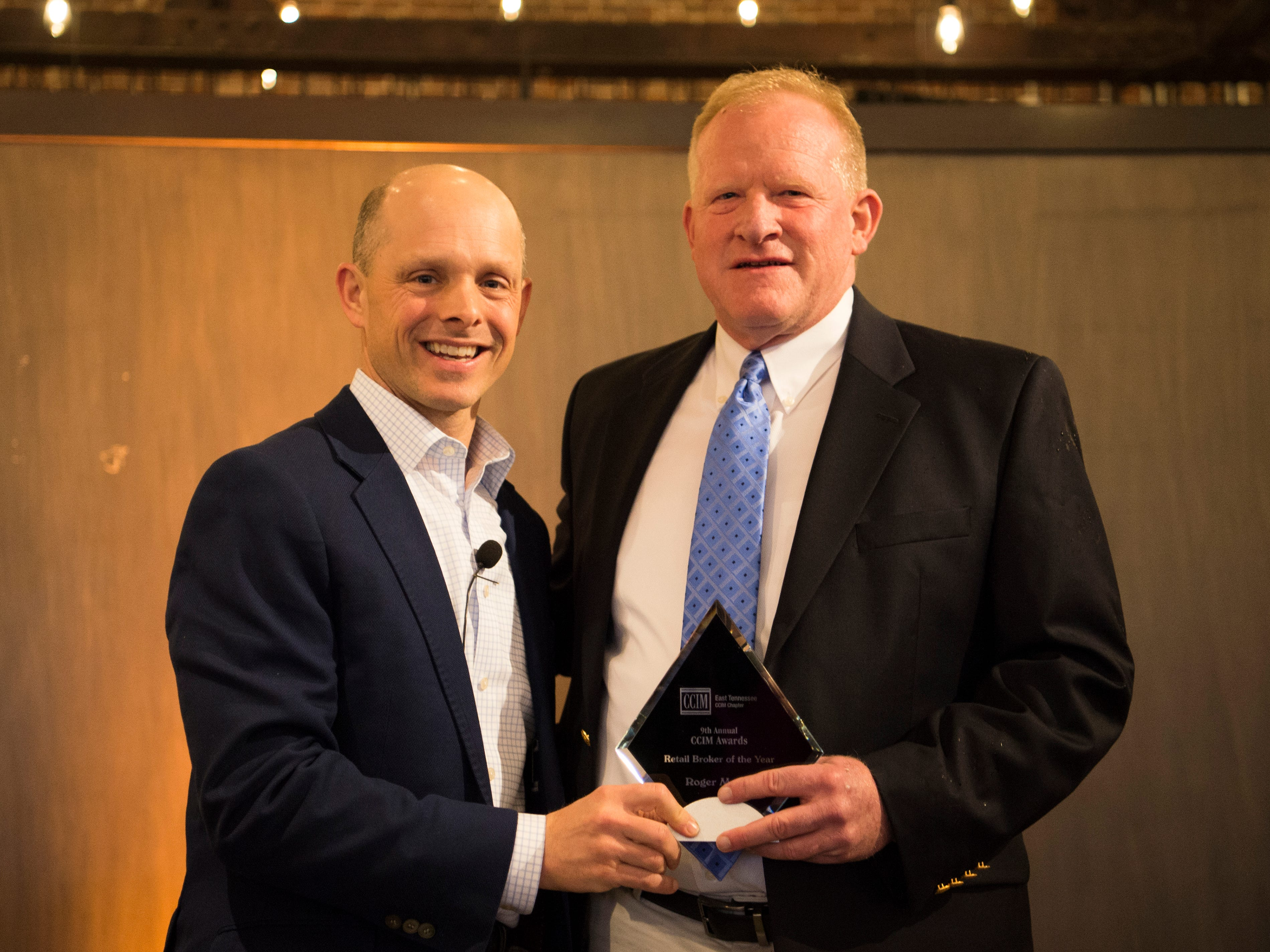 Roger Moore, right, is awarded Retail Broker of the Year at the Commercial and Residential Real Estate Awards held at The Press Room in Knoxville on Tuesday, February 12, 2019.