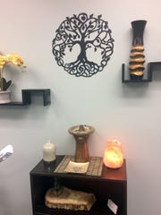 The decor in the Lotus Skin Care treatment room is designed to promote peace and tranquility.