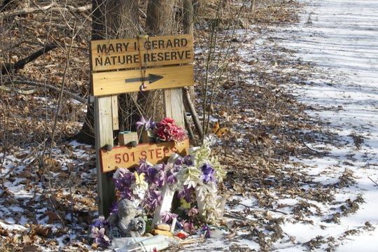 A makeshift memorial to Libby German and Abby Williams stands at the fork in the trail that leads to the Monon High Bridge. The trail to the bridge is closed, but the paths east of town still draw the curious who want to pay their respects to the girls who were killed near the trails Feb. 13, 2017.