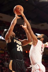Feb 12, 2019; College Park, MD, USA; Maryland Terrapins guard Eric Ayala (5) blocks Purdue Boilermakers guard Nojel Eastern (20) shot during the first half at XFINITY Center. Mandatory Credit: Tommy Gilligan-USA TODAY Sports
