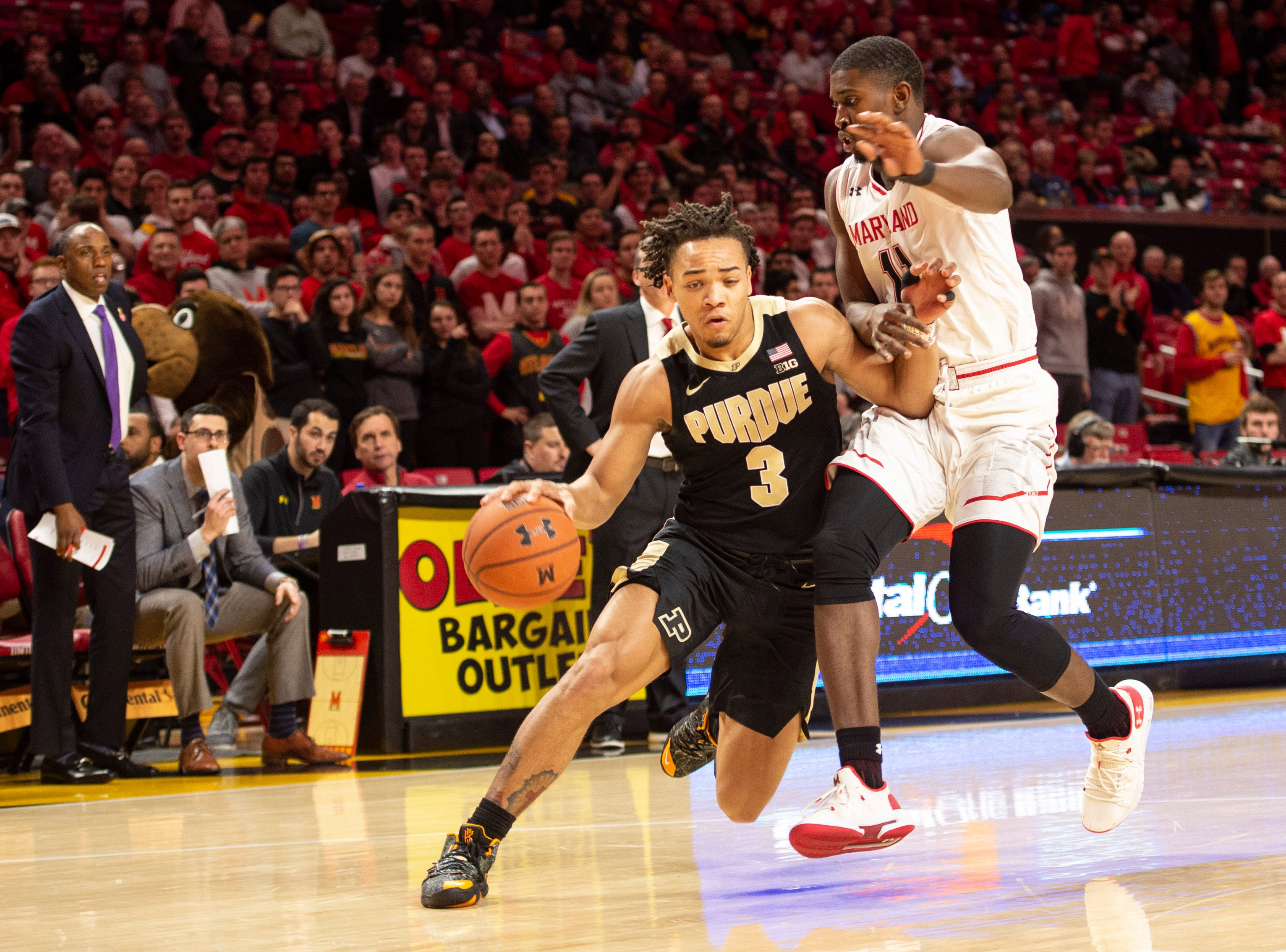 Feb 12, 2019; College Park, MD, USA; Purdue Boilermakers guard Carsen Edwards (3) makes a move to the basket as Maryland Terrapins guard Darryl Morsell (11) defends during the first half at XFINITY Center. Mandatory Credit: Tommy Gilligan-USA TODAY Sports
