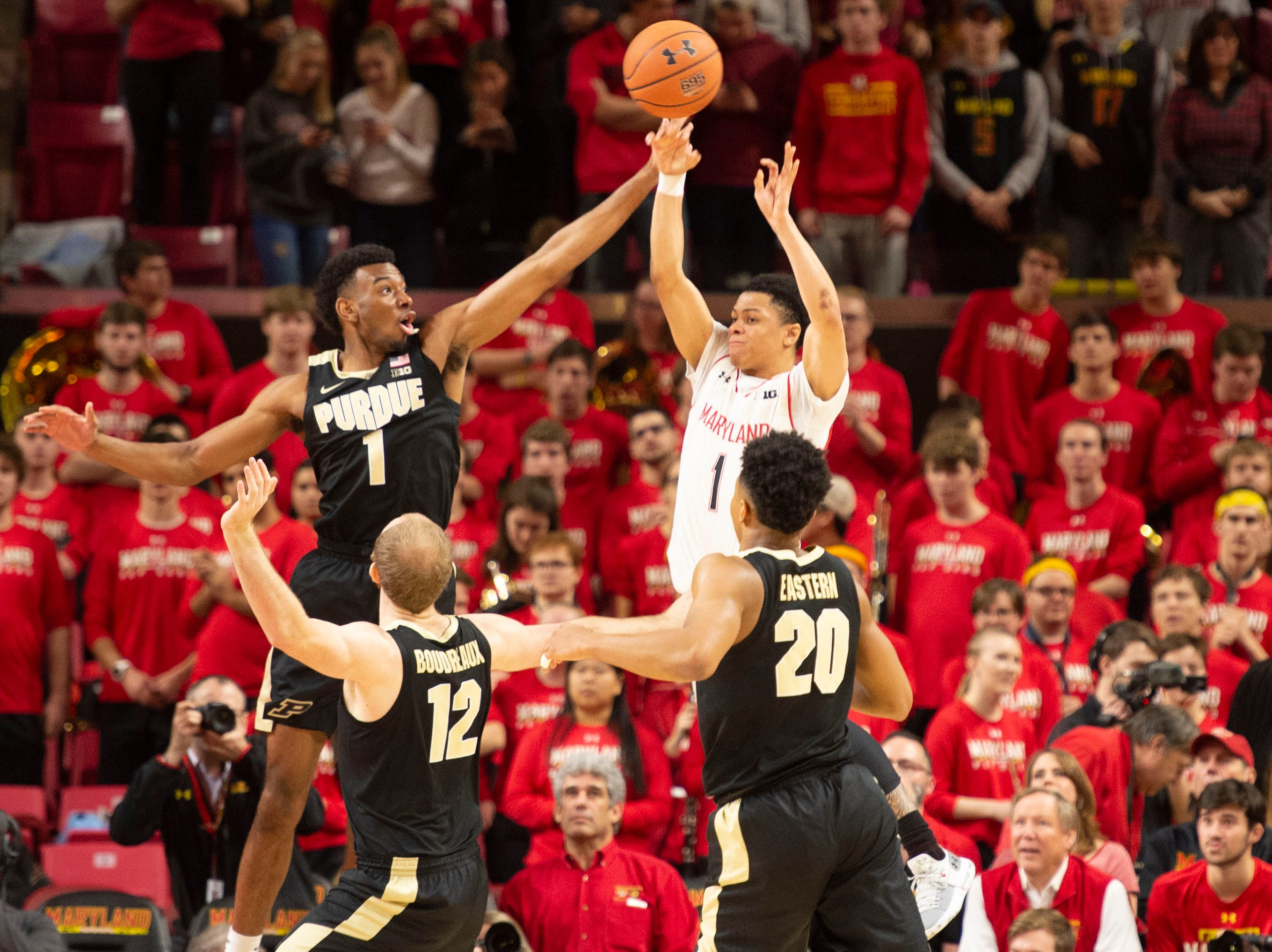Feb 12, 2019; College Park, MD, USA; Maryland Terrapins guard Anthony Cowan Jr. (1) passes past the rect of Purdue Boilermakers forward Aaron Wheeler (1) during the first half at XFINITY Center. Mandatory Credit: Tommy Gilligan-USA TODAY Sports