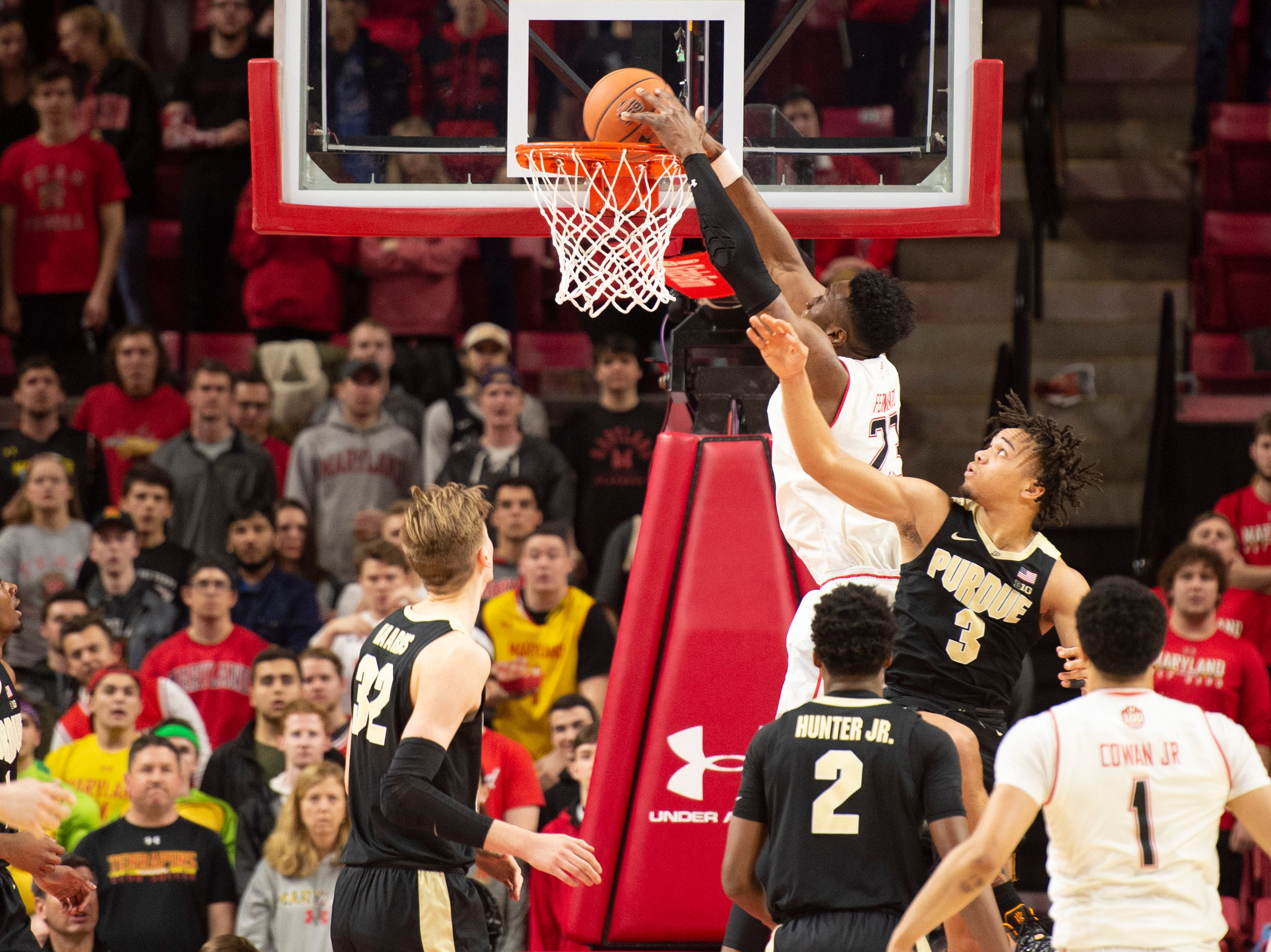 Feb 12, 2019; College Park, MD, USA; Maryland Terrapins forward Bruno Fernando (23) dunks as Purdue Boilermakers guard Carsen Edwards (3) defends during the first half at XFINITY Center. Mandatory Credit: Tommy Gilligan-USA TODAY Sports
