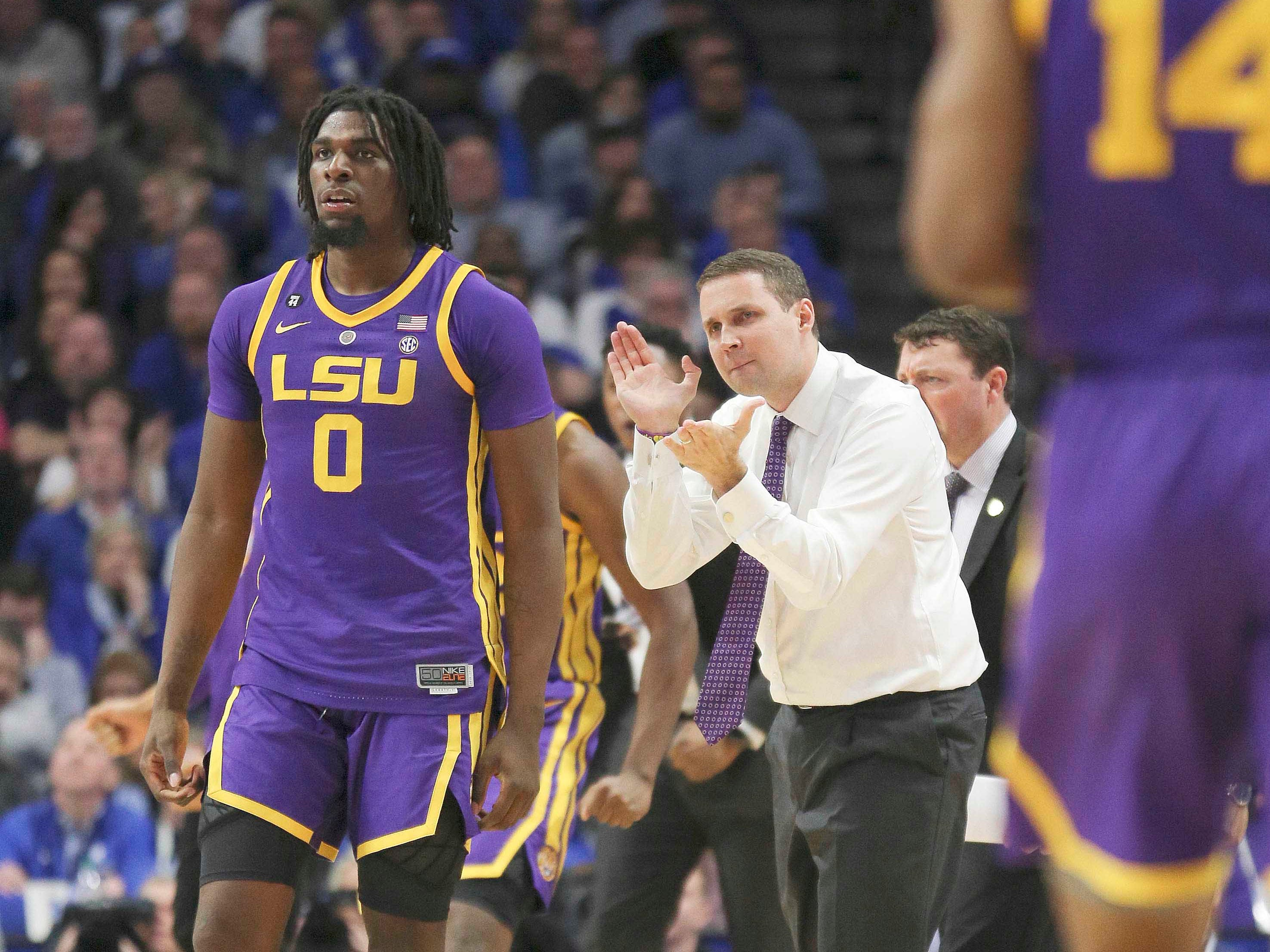 Feb 12, 2019; Lexington, KY, USA; LSU Tigers head coach Will Wade reacts along side forward Naz Reid (00) during the game against the Kentucky Wildcats in the second half at Rupp Arena. Mandatory Credit: Mark Zerof-USA TODAY Sports