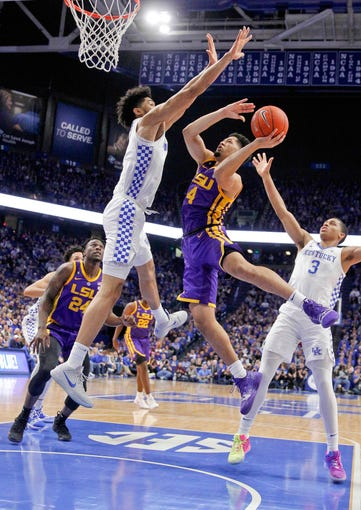 Feb 12, 2019; Lexington, KY, USA; LSU Tigers guard Skylar Mays (4) shoots the ball against Kentucky Wildcats forward Nick Richards (4) in the first half at Rupp Arena. Mandatory Credit: Mark Zerof-USA TODAY Sports