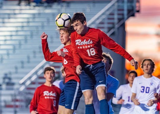 Holden Pelletier and Landon Boudreaux combine to head the ball as Teurlings Catholic Rebels take on Parkview Baptist in the LHSAA boys soccer playoffs. Tuesday, Feb. 12, 2019.