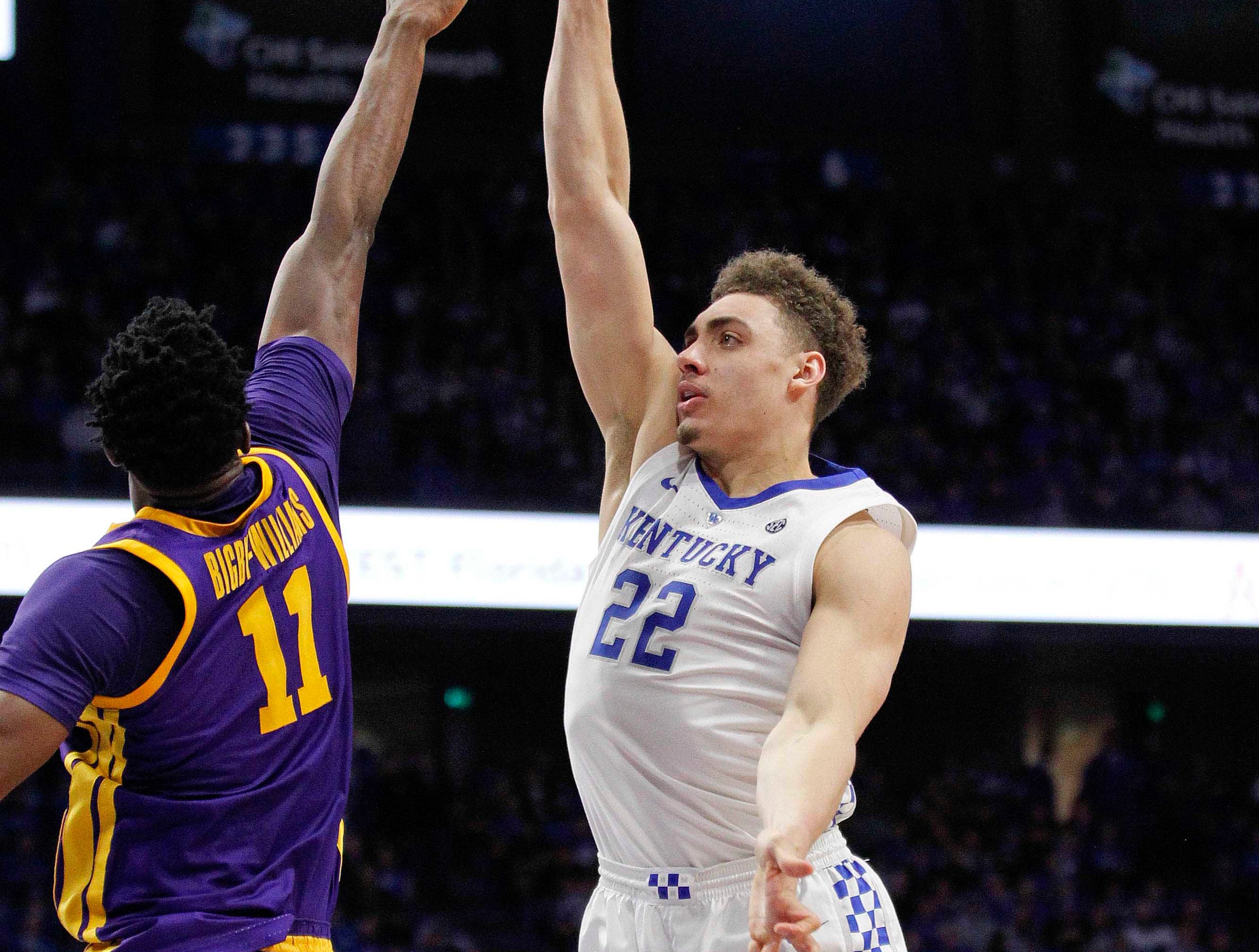 Feb 12, 2019; Lexington, KY, USA; Kentucky Wildcats forward Reid Travis (22) shoots the ball against LSU Tigers forward Kavell Bigby-Williams (11) in the first half at Rupp Arena. Mandatory Credit: Mark Zerof-USA TODAY Sports