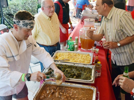 Dr. Jonathan Hunter (left) prepares a dish, the Soul Food Parfait,  for a fundraising event, Men Who Cook and Men Who Mix that benefits the River Oaks Arts Center in Alexandria. Hunter was part of Team Lagniappe Home Care consisting of Hunter, Tom Spencer, Judge Dee Drell, Brad Drell and Dr. Ken Brown. The team placed third.