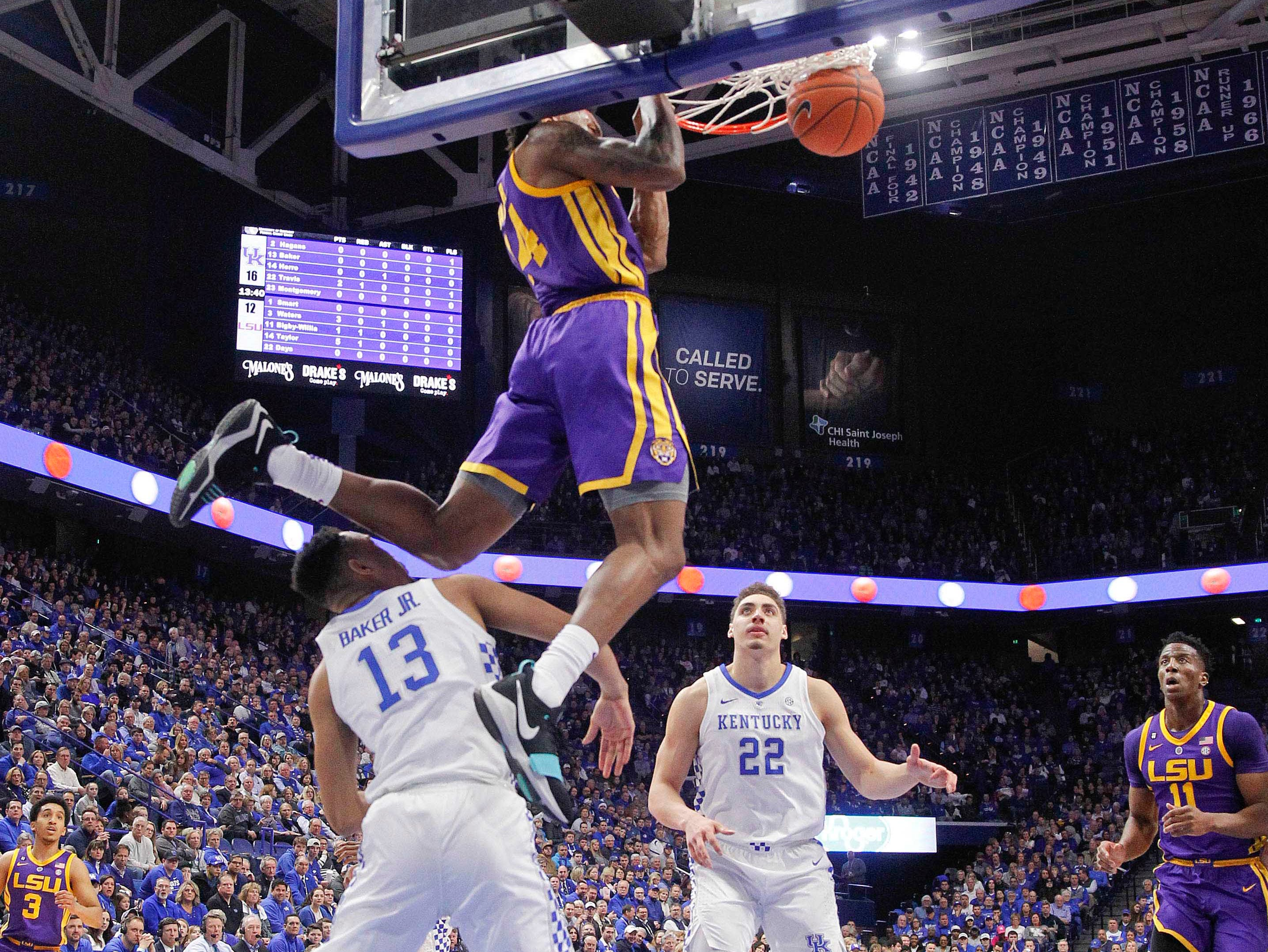 Feb 12, 2019; Lexington, KY, USA; LSU Tigers guard Marlon Taylor (14) dunks the ball against Kentucky Wildcats guard Jemarl Baker (13) in the second half at Rupp Arena. Mandatory Credit: Mark Zerof-USA TODAY Sports