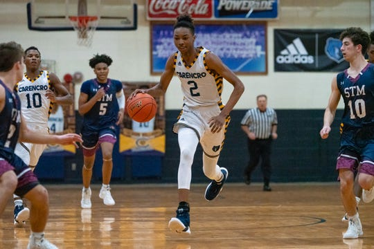 Carencro's Joseph Charles sprints down the court with the ball as the Carencro High Bears take on the St. Thomas More Cougars at home on Feb. 12, 2019.