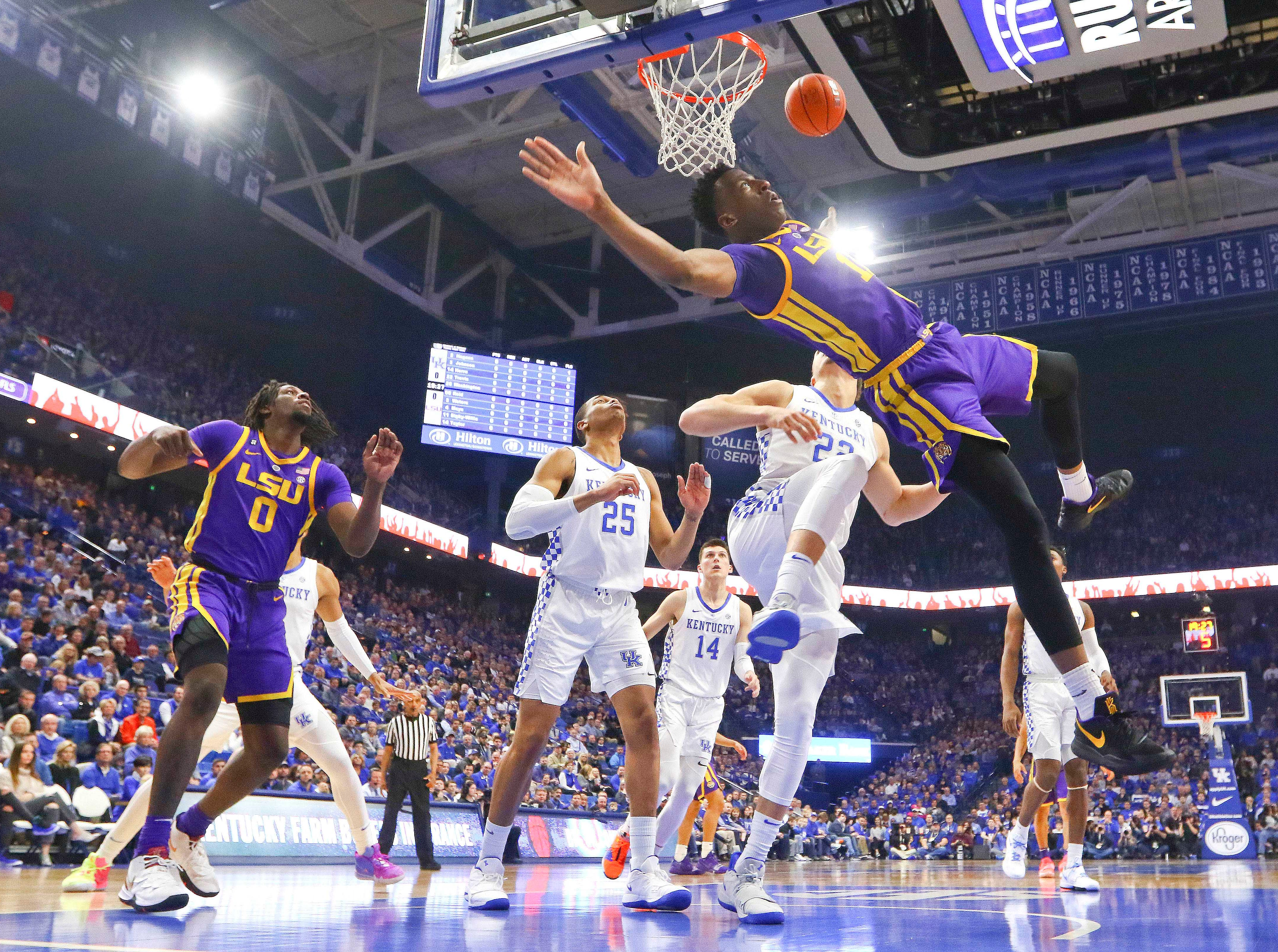 Feb 12, 2019; Lexington, KY, USA; LSU Tigers guard Ja'vonte Smart (1) is fouled by Kentucky Wildcats forward Reid Travis (22) in the first half at Rupp Arena. Mandatory Credit: Mark Zerof-USA TODAY Sports
