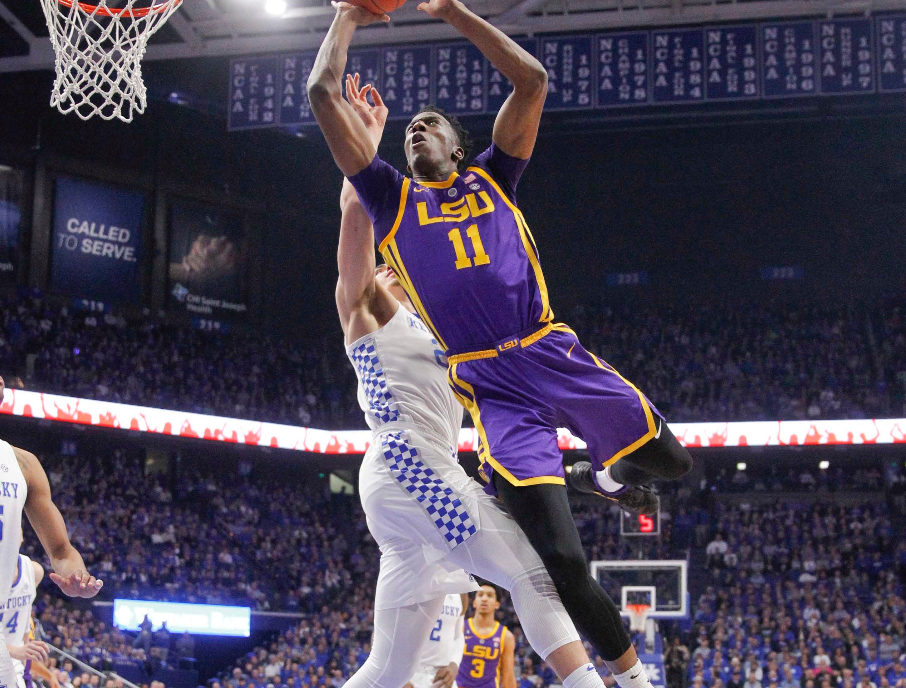 Feb 12, 2019; Lexington, KY, USA; LSU Tigers forward Kavell Bigby-Williams (11) shoots the ball against Kentucky Wildcats forward Reid Travis (22) in the second half at Rupp Arena. Mandatory Credit: Mark Zerof-USA TODAY Sports