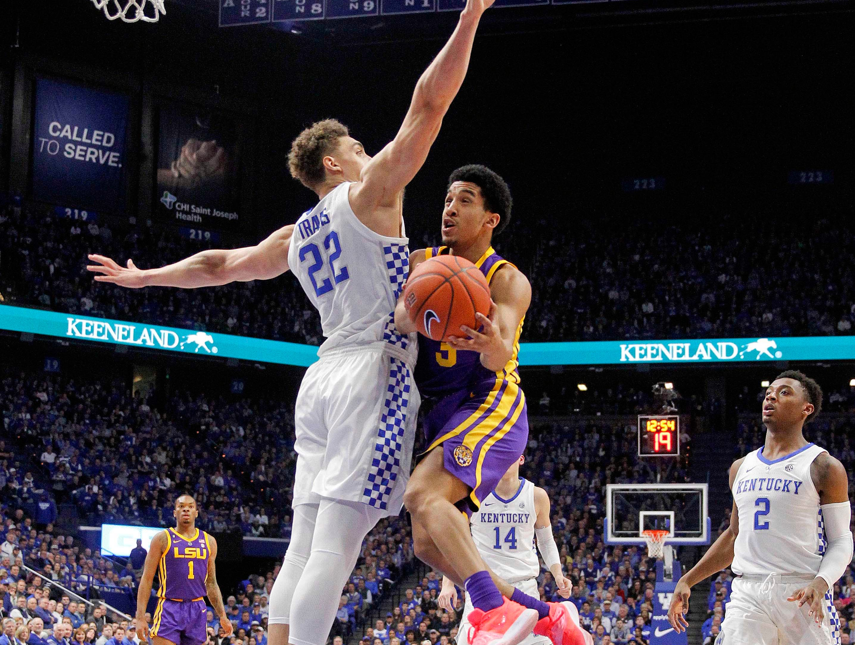 Feb 12, 2019; Lexington, KY, USA; LSU Tigers guard Tremont Waters (3) shoots the ball against Kentucky Wildcats forward Reid Travis (22) in the first half at Rupp Arena. Mandatory Credit: Mark Zerof-USA TODAY Sports