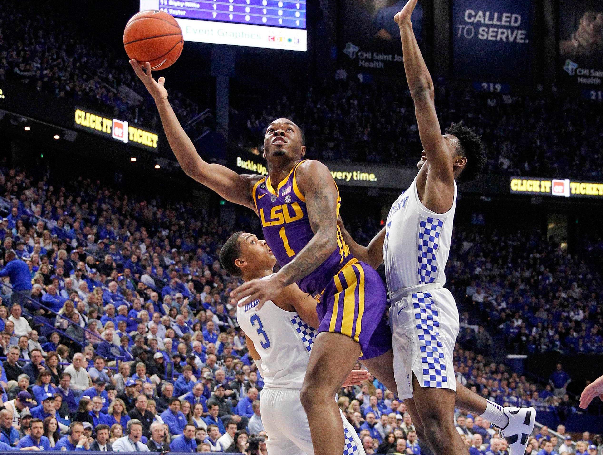 Feb 12, 2019; Lexington, KY, USA; LSU Tigers guard Ja'vonte Smart (1) shoots the ball against Kentucky Wildcats guard Keldon Johnson (3) in the first half at Rupp Arena. Mandatory Credit: Mark Zerof-USA TODAY Sports