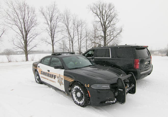 Livingston County Sheriff's deputies search on Robb Road for a young boy believed to be missing in Conway Township Wednesday, Feb. 13, 2019.