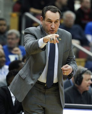 Duke head coach Mike Krzyzewski calls in a play against U of L at the Yum Center.