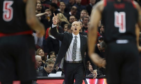 U of L head coach Chris Mack calls in a play against Duke at the Yum Center.