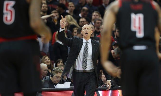 U of L head coach Chris Mack calls in a play against Duke at the Yum Center.Feb. 12, 2019
