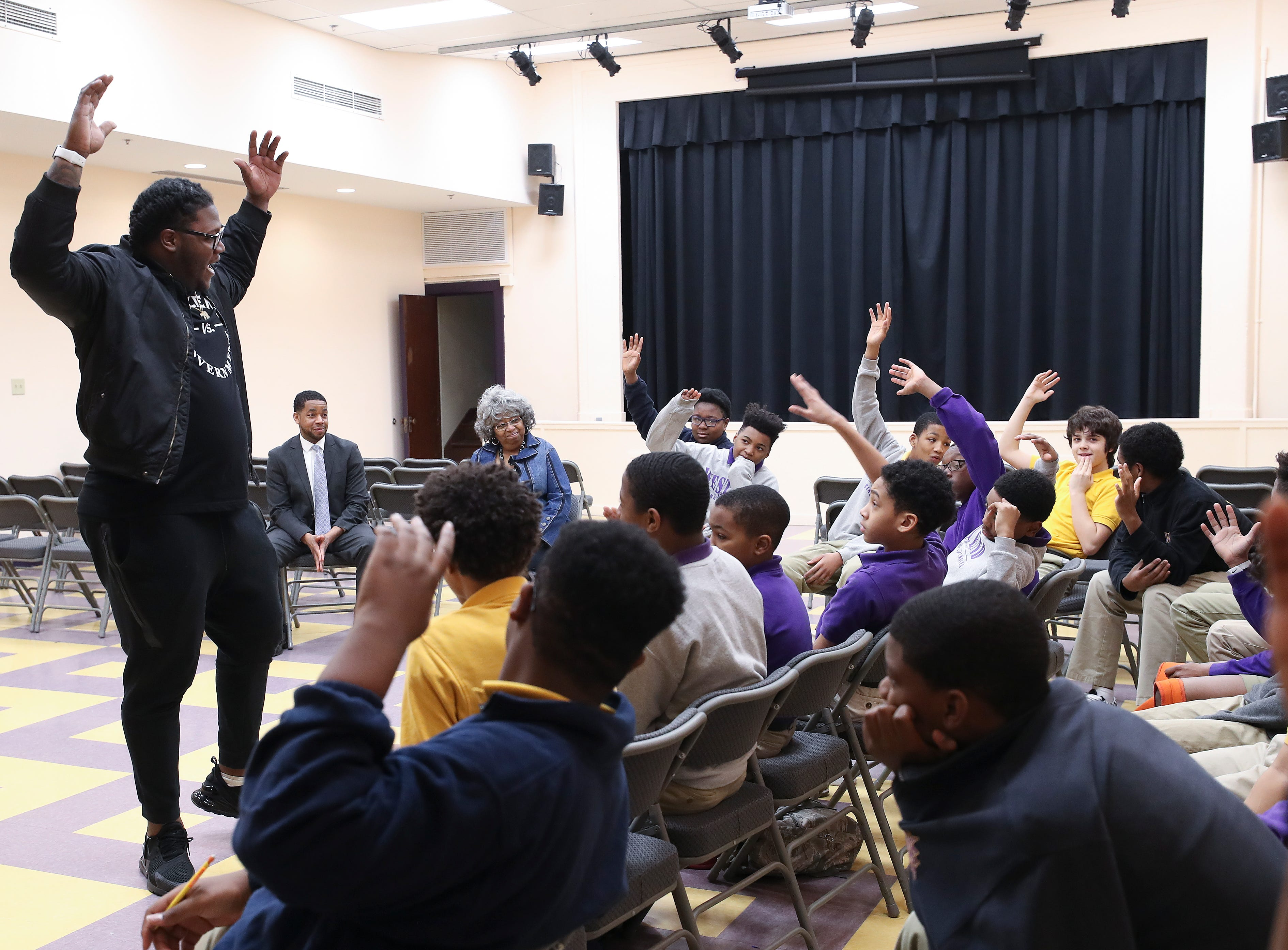 Jamon Brown, a former U of L football player who is in the NFL now, spoke to a group of students at the West End School about ways to prevent bullying.  He asked the students to raise their hands if they could commit to helping to prevent bullying.  He plays right guard for the New York Giants.Feb. 11, 2019