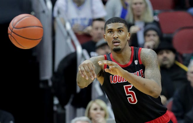 Louisville's Malik Williams passes the ball out of pressure.    Feb. 12, 2019