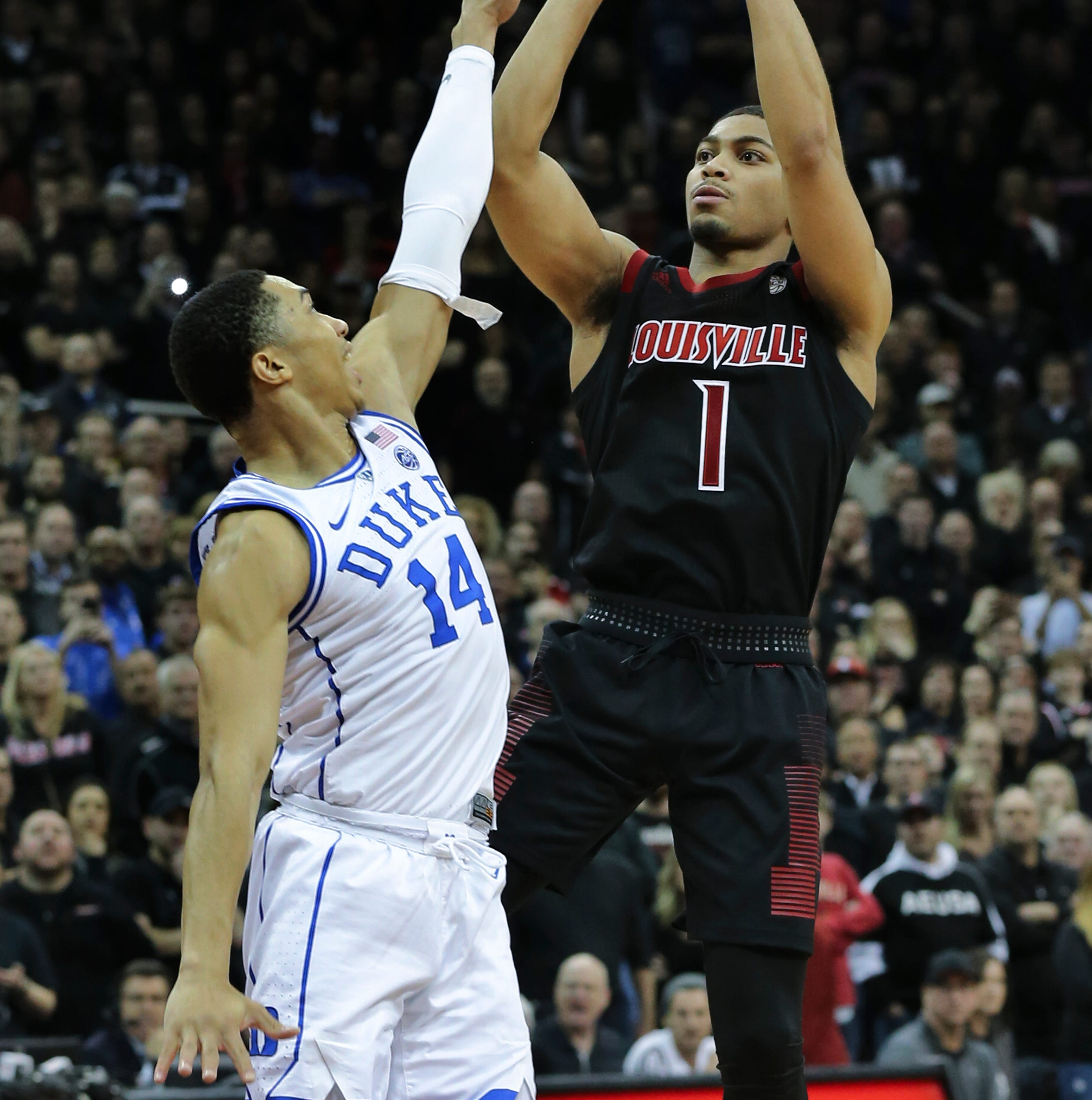U of L's Christen Cunningham (1) gets one last look at the basket against Duke's Jordan Goldwire (14) at the Yum Center, but the shot came up short near the end of the game.  Duke shot free throws to win 71-69.Feb. 12, 2019