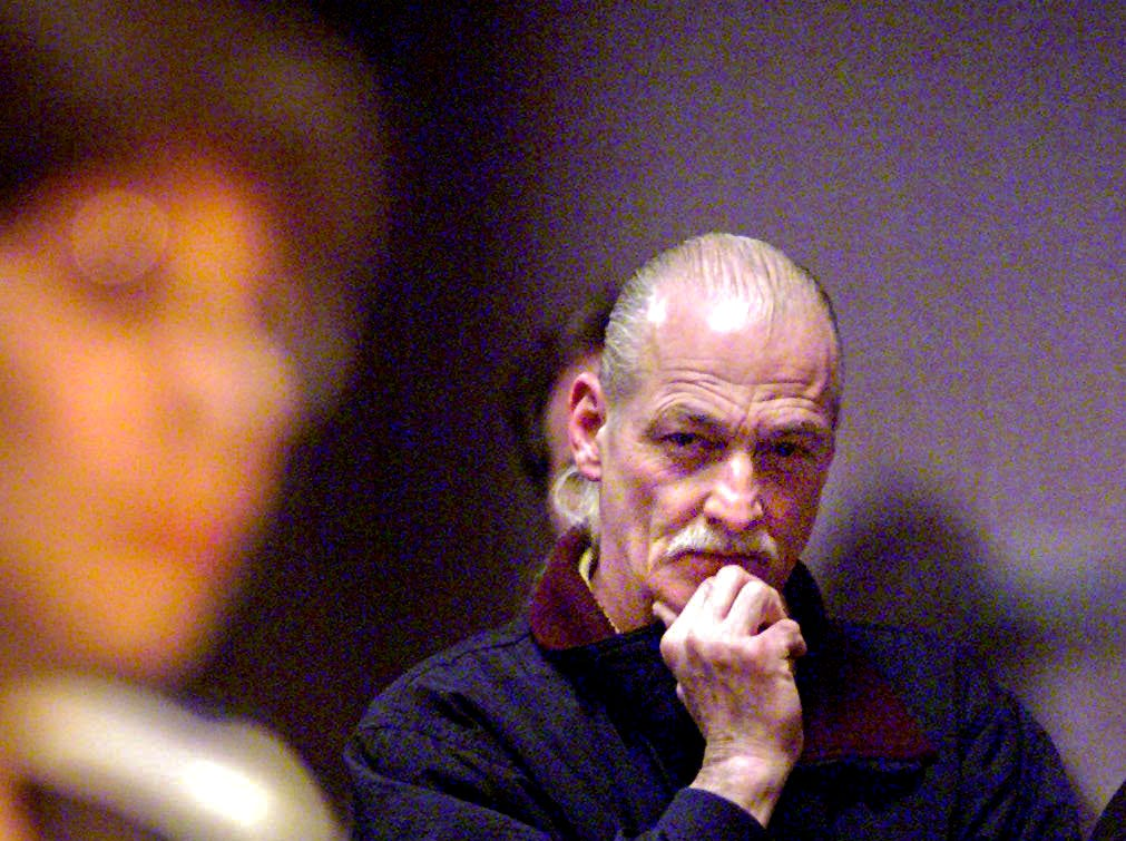 Vaughn Schneider, owner of Small Planet Food and Spirits in East Lansing, listens as an East Lansing resident voices concerns about a riot during a public forum at City Hall on Monday, March 29, 1999, two days after the incident.