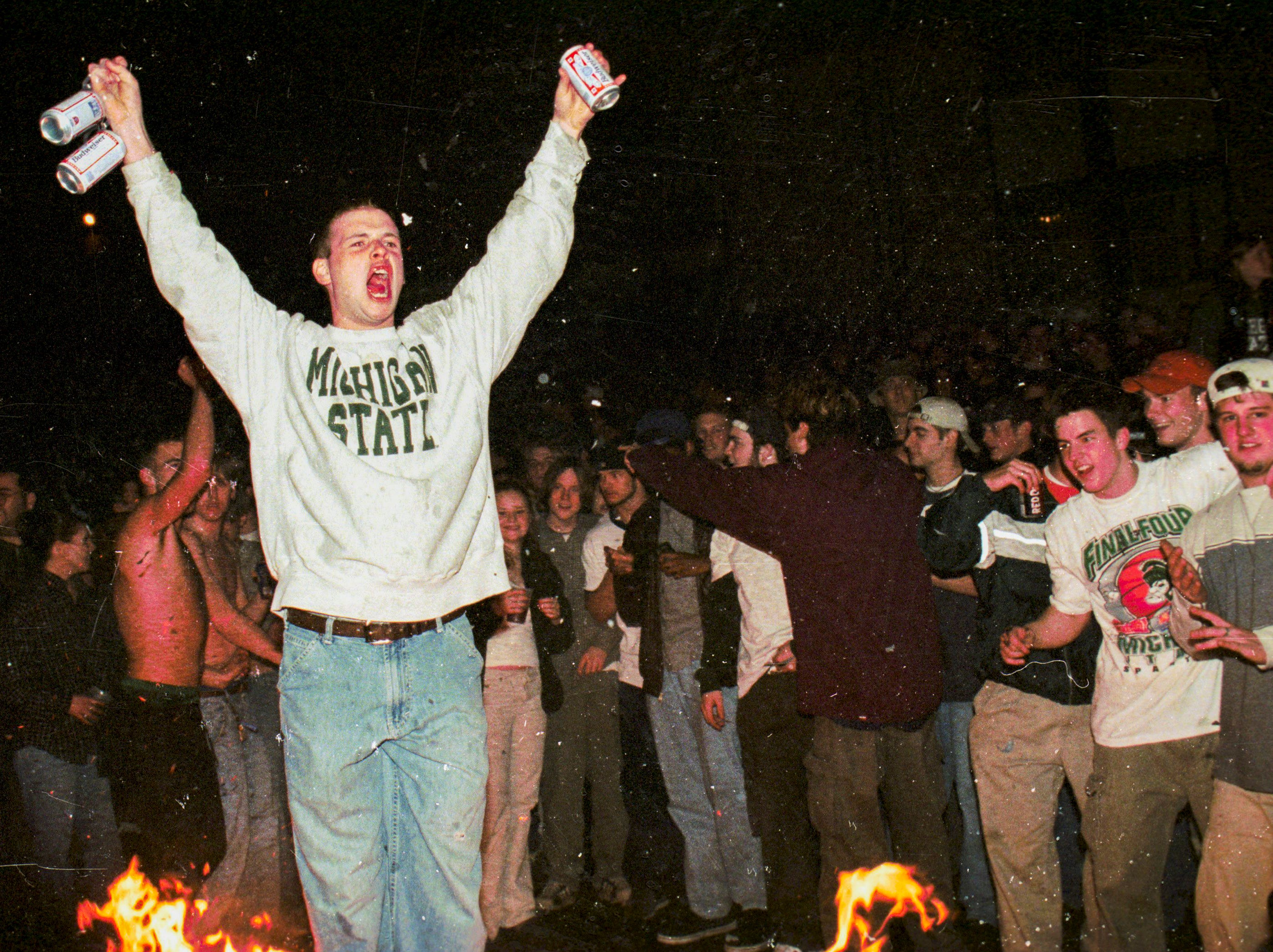 A young man yells out near a fire set in Cedar Village during a riot on Saturday, March 27, 1999, in East Lansing.
