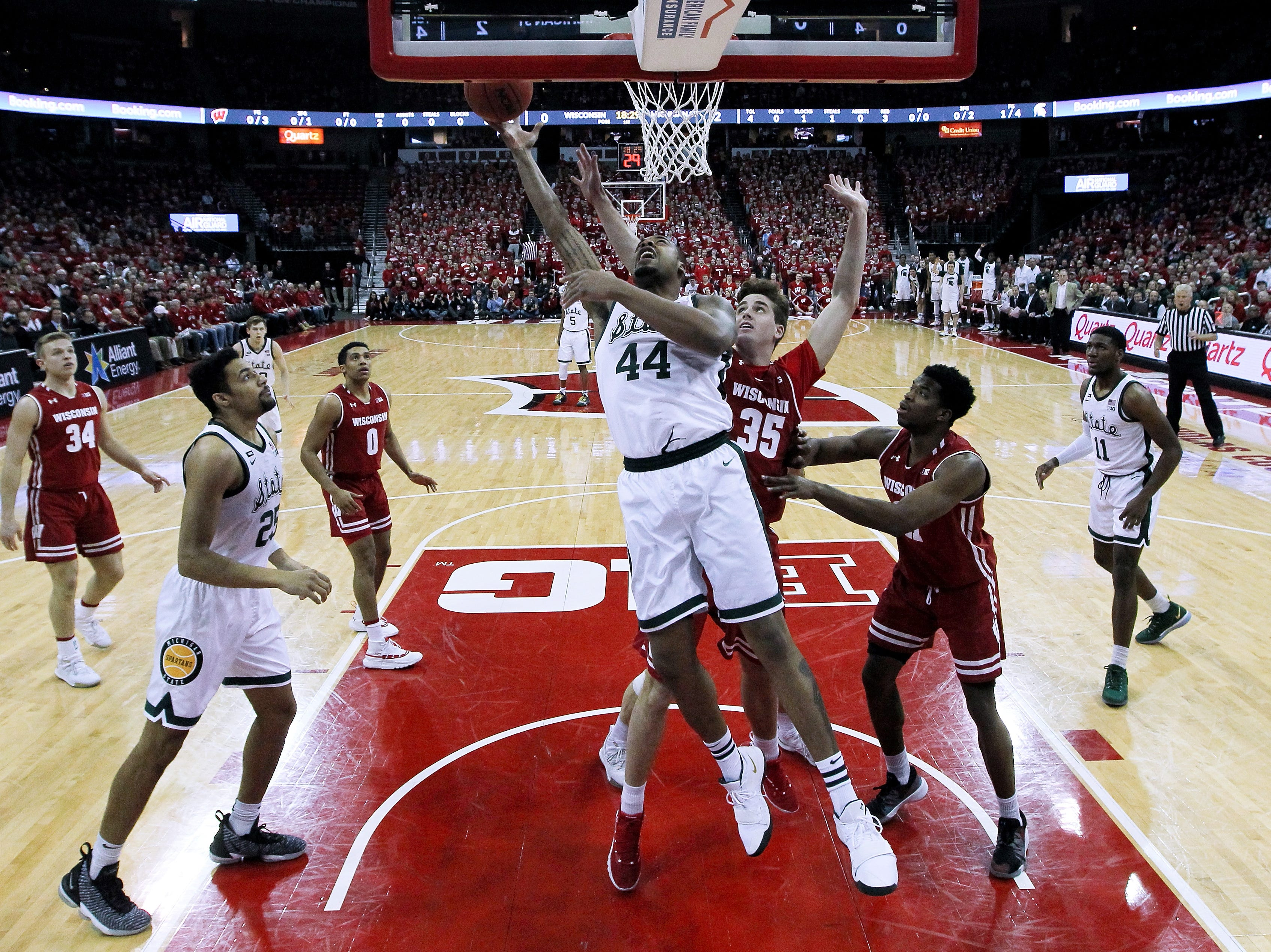 Nick Ward #44 of the Michigan State Spartans attempts a shot while being guarded by Nate Reuvers #35 of the Wisconsin Badgers in the first half at the Kohl Center on February 12, 2019 in Madison, Wisconsin.