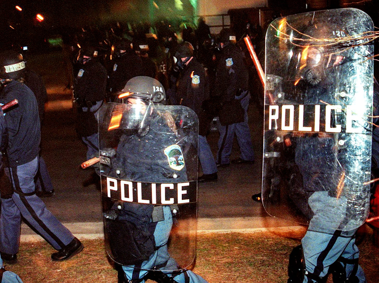 The first wave of police in full riot gear heading into Cedar Village on Saturday, March 27, 1999, in East Lansing.