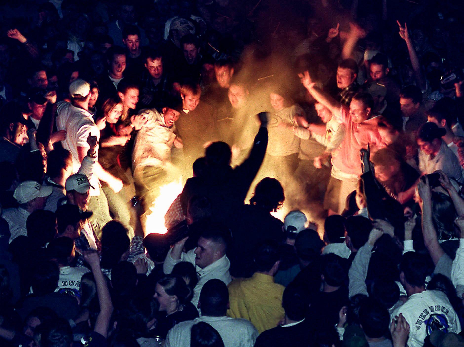 People start a fire in Cedar Village after the Spartans lost to Duke in the Final Four of the NCAA Men's Basketball Tournament on Saturday, March 27, 1999, in East Lansing.