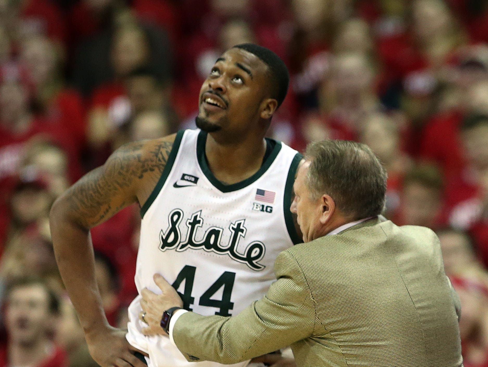 Michigan State Spartans forward Nick Ward (44) listens to Michigan State Spartans head coach Tom Izzo during the game with the Wisconsin Badgersat the Kohl Center.