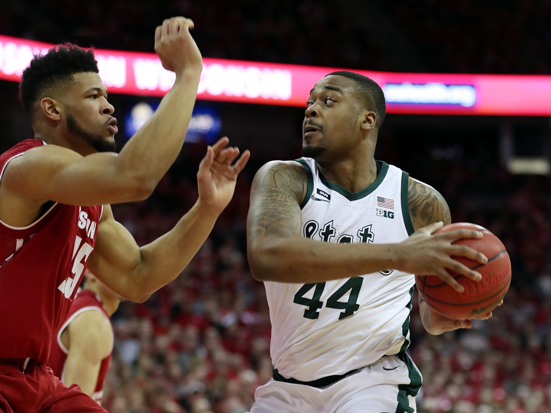 Michigan State Spartans forward Nick Ward (44) controls the ball as Wisconsin Badgers forward Charles Thomas (15) defends during the first half at the Kohl Center.