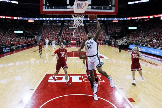 Nick Ward #44 of the Michigan State Spartans dunks the ball in the first half against the Wisconsin Badgers at the Kohl Center on February 12, 2019 in Madison, Wisconsin.