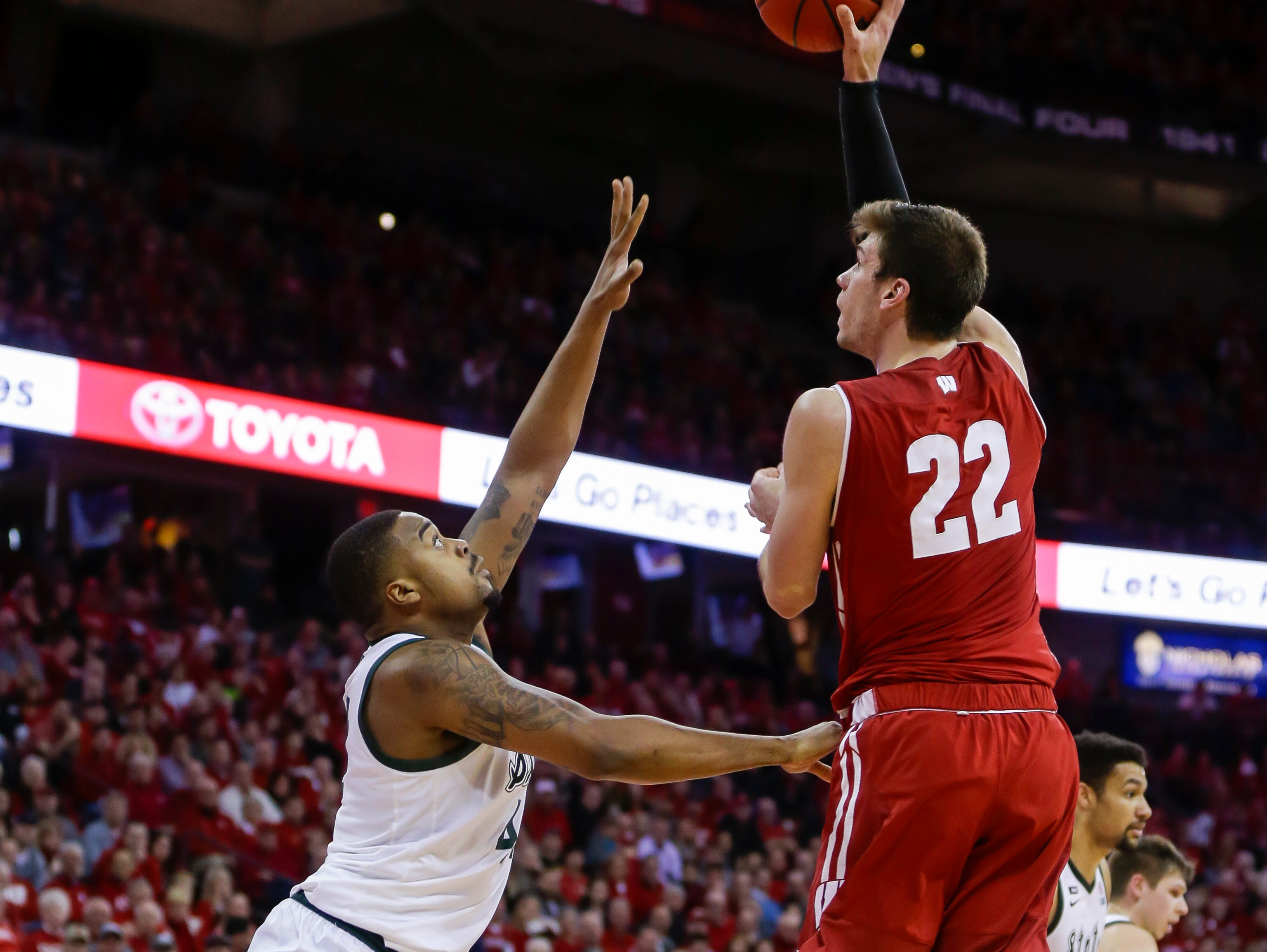Wisconsin's Ethan Happ (22) shoots for his 2,000th career point during the second half of the team's NCAA college basketball game against Michigan State on Tuesday, Feb. 12, 2019, in Madison, Wis. Michigan State won 67-59.