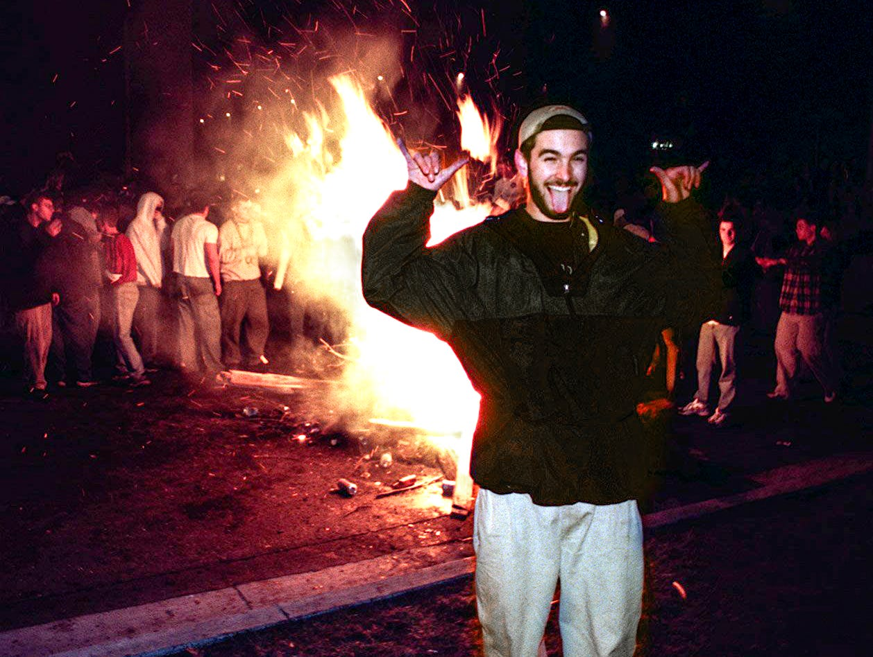 A  man makes faces near a bonfire at Cedar Village in East Lansing after Michigan State University lost to Duke in the Final Four of the NCAA Men's Basketball Tournament on Saturday, March 27, 1999.