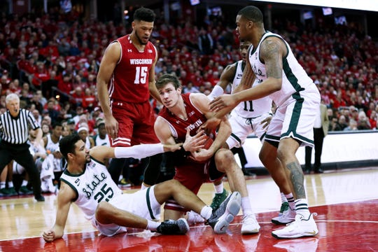Ethan Happ #22 of the Wisconsin Badgers calls for a timeout in the first half against the Michigan State Spartans at the Kohl Center on February 12, 2019 in Madison, Wisconsin.