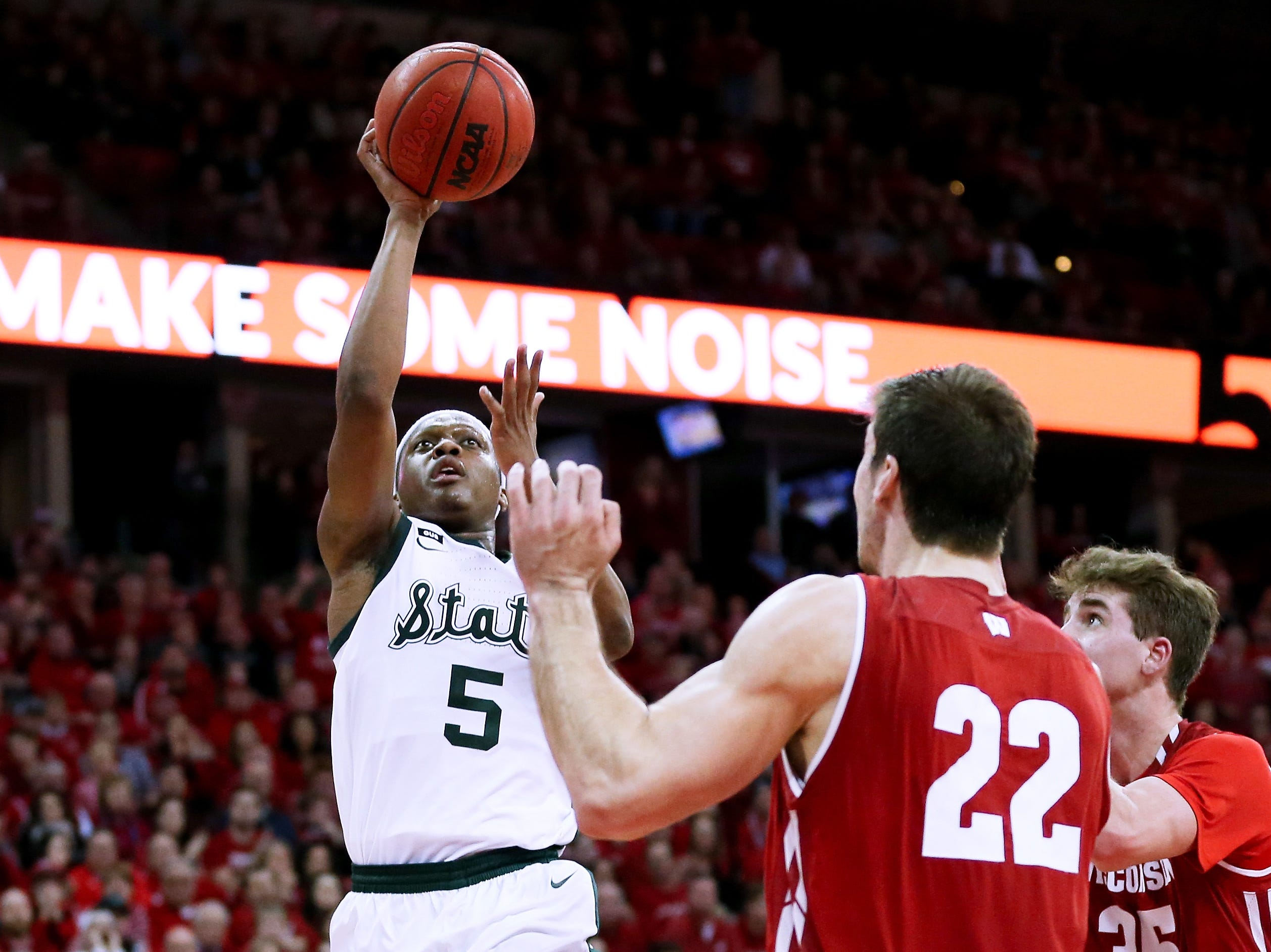 Cassius Winston #5 of the Michigan State Spartans attempts a shot while being guarded by Ethan Happ #22 of the Wisconsin Badgers in the second half at the Kohl Center on February 12, 2019 in Madison, Wisconsin.