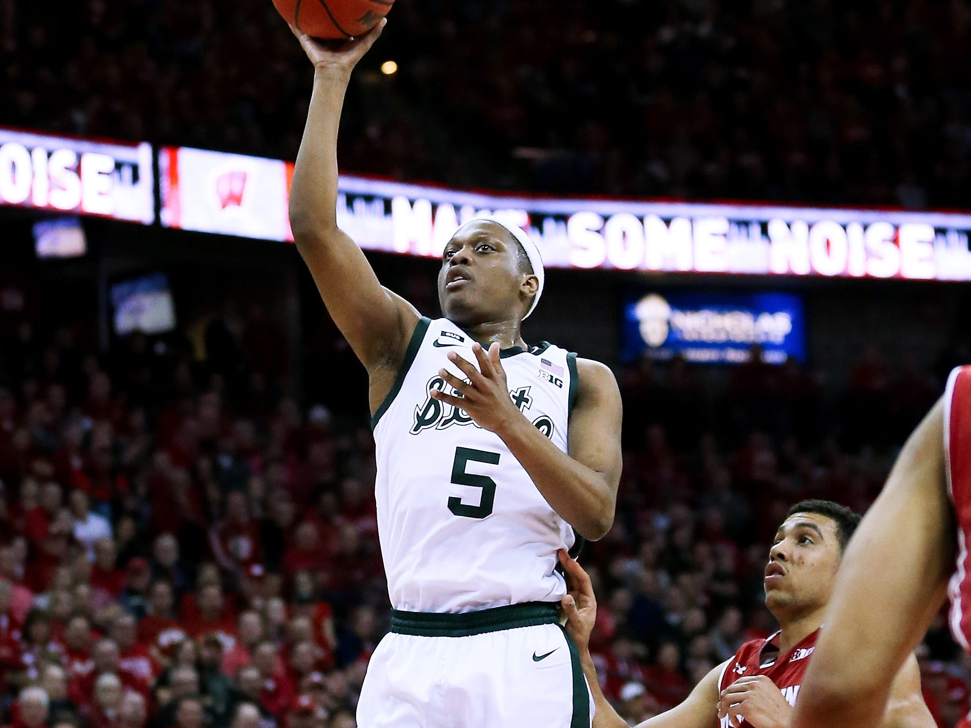 Cassius Winston #5 of the Michigan State Spartans attempts a shot in the second half against the Wisconsin Badgers at the Kohl Center on February 12, 2019 in Madison, Wisconsin.