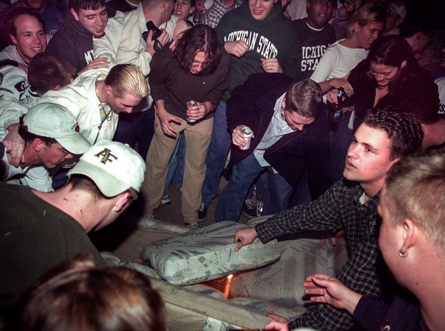 Michigan State University students and others start a couch on fire in Cedar Village in East Lansing on Saturday, March 27, 1999, after MSU lost to Duke 68-62 during a Final Four game in the NCAA Men's Basketball Tournament.