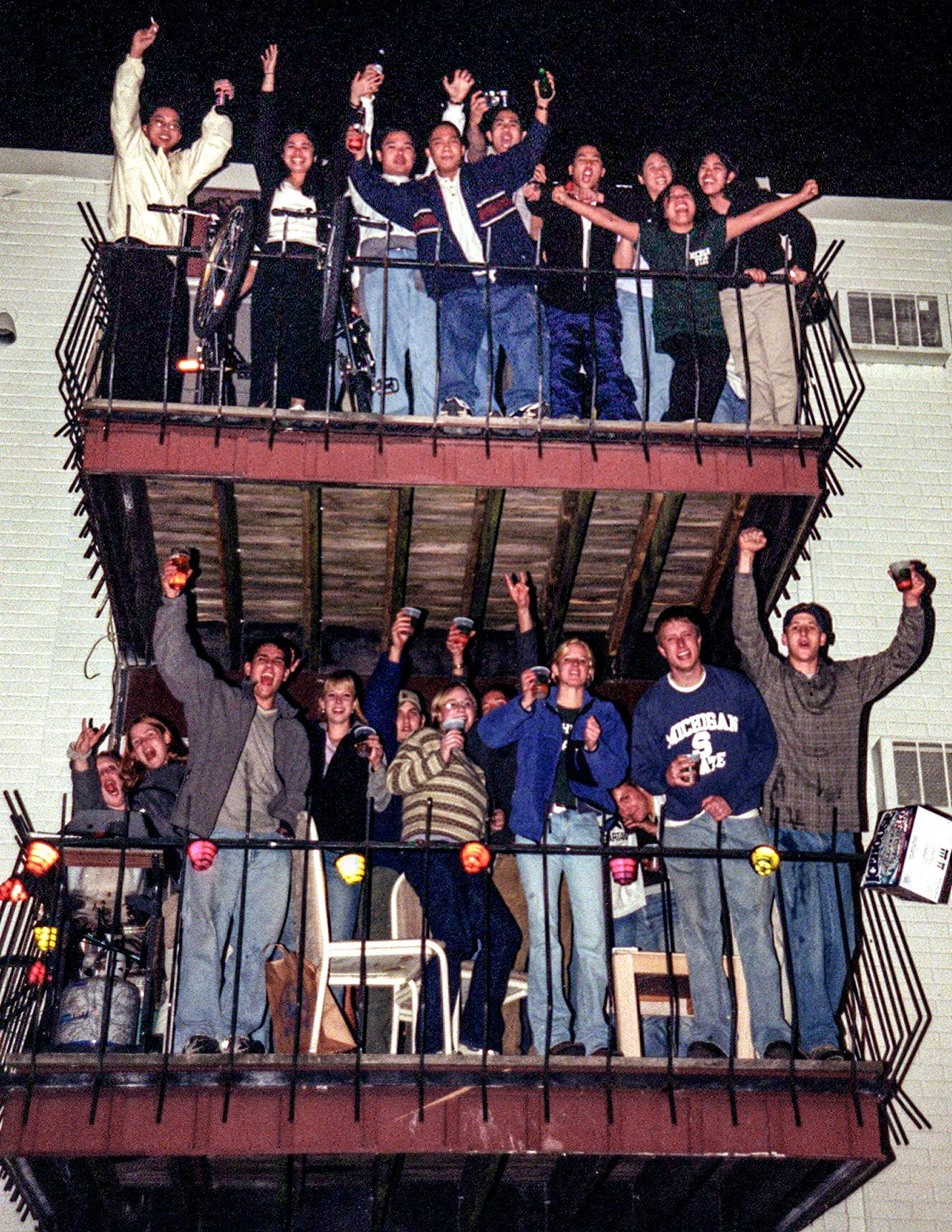 Cedar Village residents applaud during half-time of a Final Four diversion between Michigan State University and Duke in a NCAA Men's Basketball Tournament  on Saturday, Mar 27, 1999, in East Lansing. MSU mislaid a game, triggering bonfires and riots in a city.