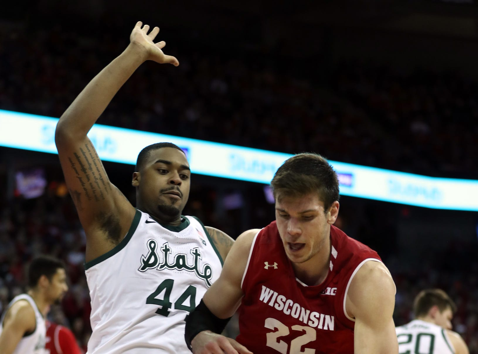 Wisconsin Badgers forward Ethan Happ (22) dribbles the ball as Michigan State Spartans forward Nick Ward (44) defends during the second half at the Kohl Center.