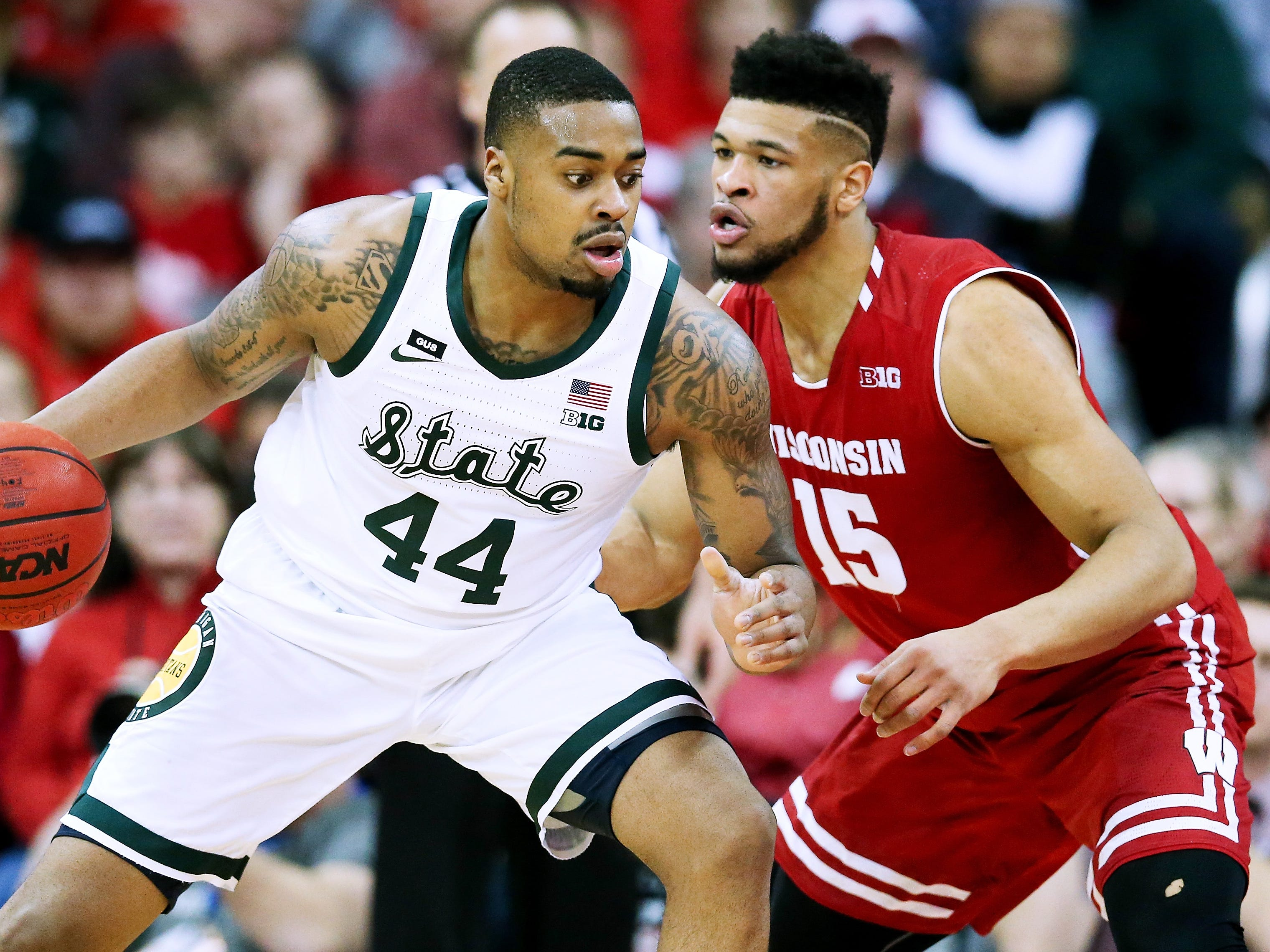 Nick Ward #44 of the Michigan State Spartans dribbles the ball while being guarded by Charles Thomas IV #15 of the Wisconsin Badgers in the first half at the Kohl Center on February 12, 2019 in Madison, Wisconsin.