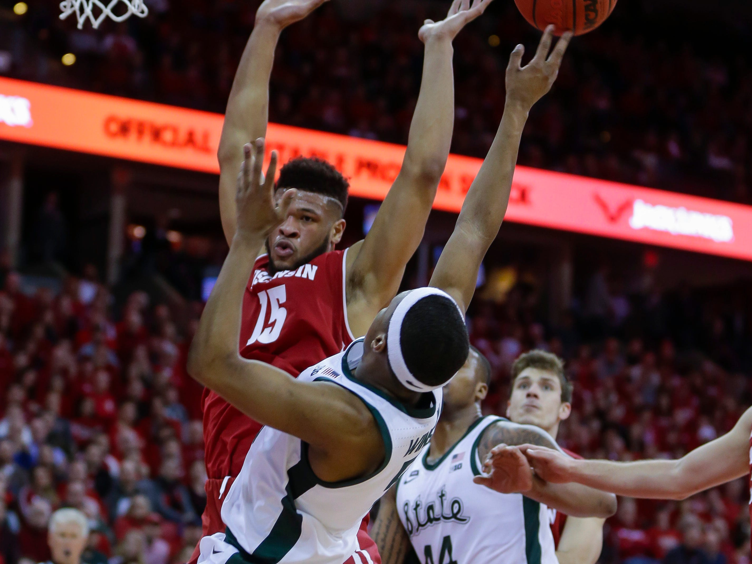 Michigan States's Kyle Ahrens (0) shoots as Wisconsin's Charles Thomas (15) defends during the first half of an NCAA college basketball game Tuesday, Feb. 12, 2019, in Madison, Wis.