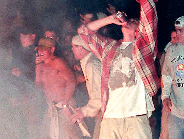 People watch a couch burn at Cedar Village after MSU was beaten by Duke in the Final Four of the NCAA Men's Basketball Tournament on Saturday, March 27, 1999, in East Lansing.