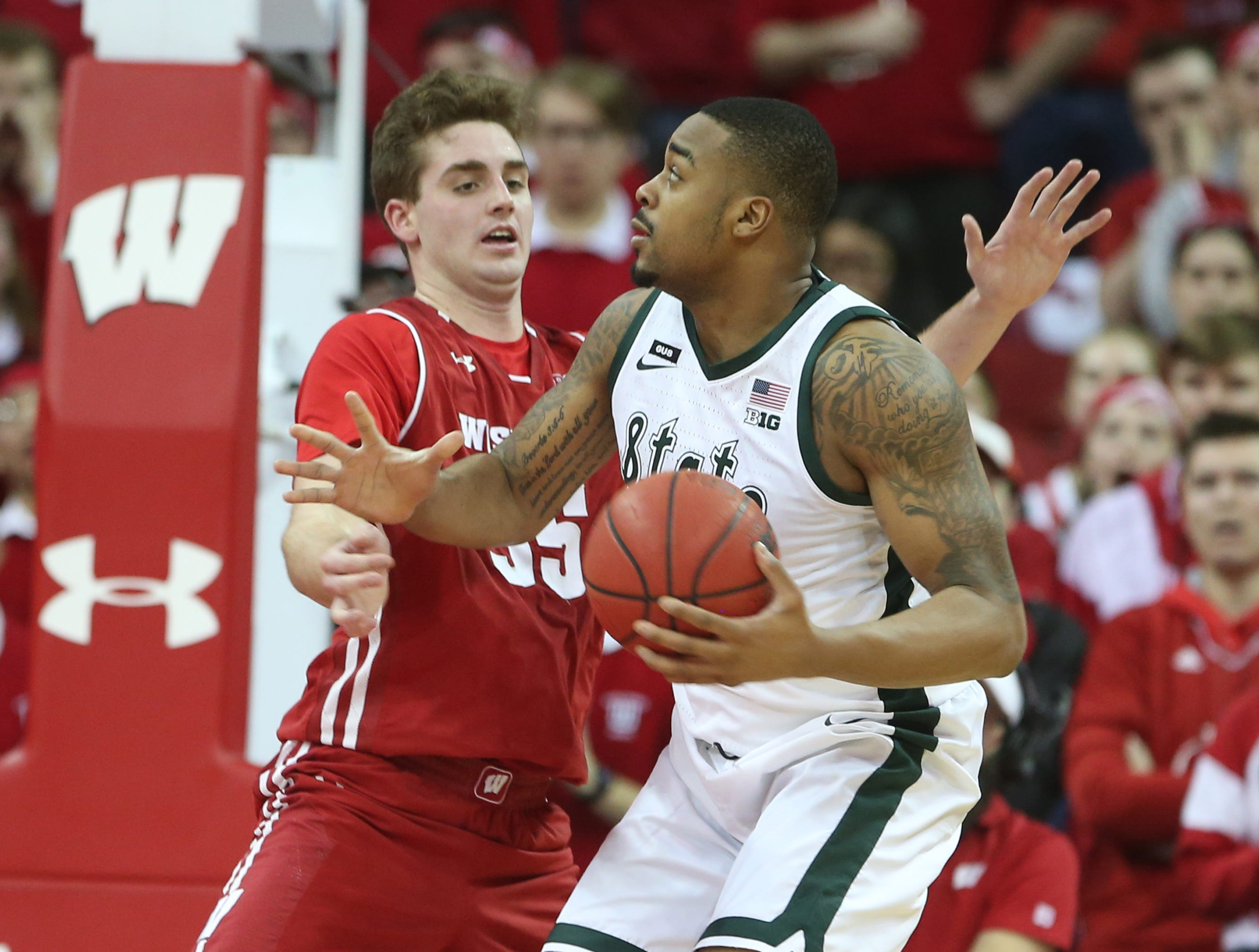 Michigan State Spartans forward Nick Ward (44) controls the ball as Wisconsin Badgers forward Nate Reuvers (35) defends at the Kohl Center.